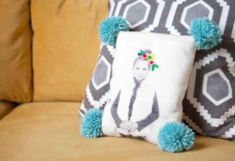 pompoms decorate cushion